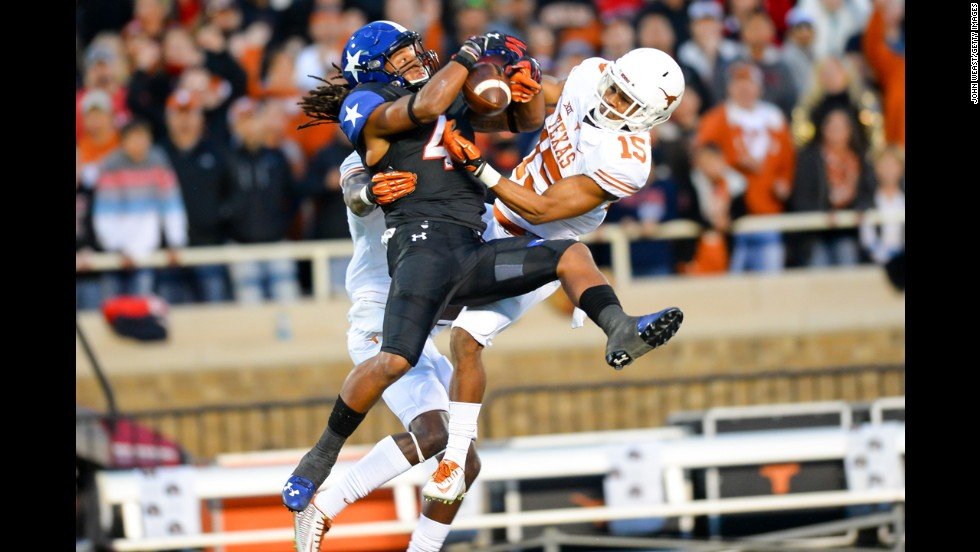 Texas Tech wide receiver Bradley Marquez, center, tries to make a catch while being defended by two Texas Longhorns on Saturday, November 1. Texas won the game 34-13.
