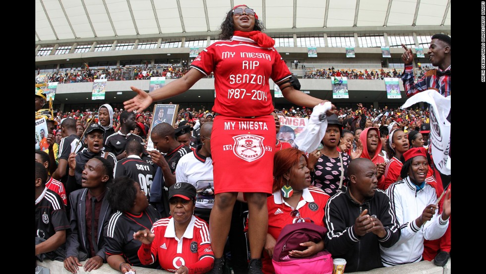 "Fans in Durban, South Africa, express their emotions during the funeral service of Senzo Meyiwa, the captain of South Africa's soccer team who authorities say <a href=""http://www.cnn.com/2014/10/27/sport/football/football-world-mourns-senzo-meyiwa-death/index.html"">was shot and killed by intruders</a> during a botched robbery attempt."