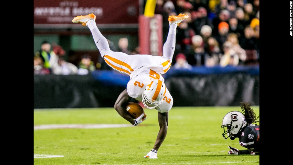 Tennessee wide receiver Pig Howard is upended during a college football game at South Carolina on Saturday, November 1. Tennessee won in overtime after trailing by two touchdowns in the fourth quarter.