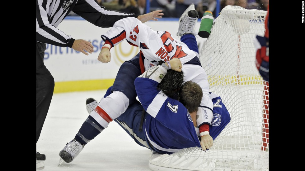 "Washington's Tom Wilson, left, and Tampa Bay's Radko Gudas brawl during an NHL game Saturday, November 1, in Tampa, Florida. <a href=""http://www.cnn.com/2014/10/28/worldsport/gallery/what-a-shot-1028/index.html"">See 40 amazing sports photos from last week</a>"