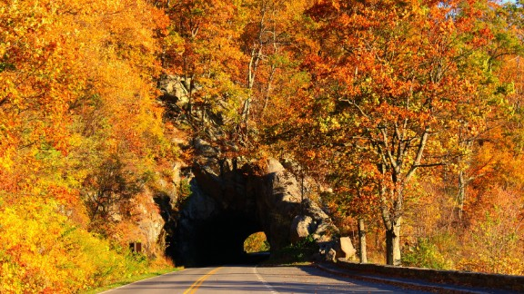 Fall leaves frame a tunnel at Skyline Drive in Shenandoah National Park. This 105-mile byway makes its way along the Blue Ridge Mountains.