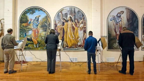 People vote inside the Krishna Temple in Salt Lake City, Utah.