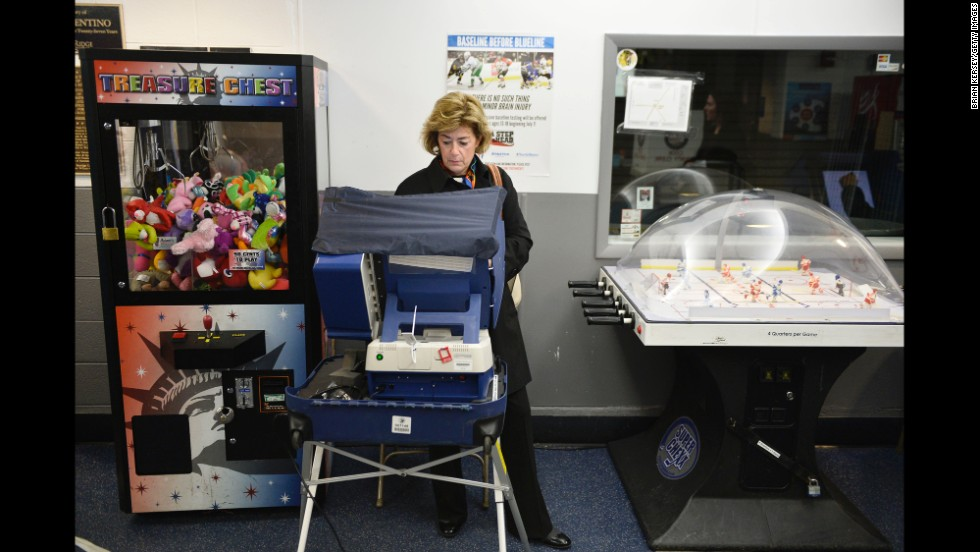 A woman votes at the Oakton Ice Arena in Park Ridge, Illinois.