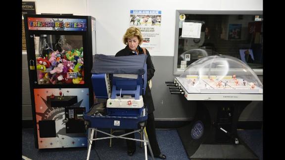 A woman votes at the Oakton Ice Arena in Park Ridge, Illinois.