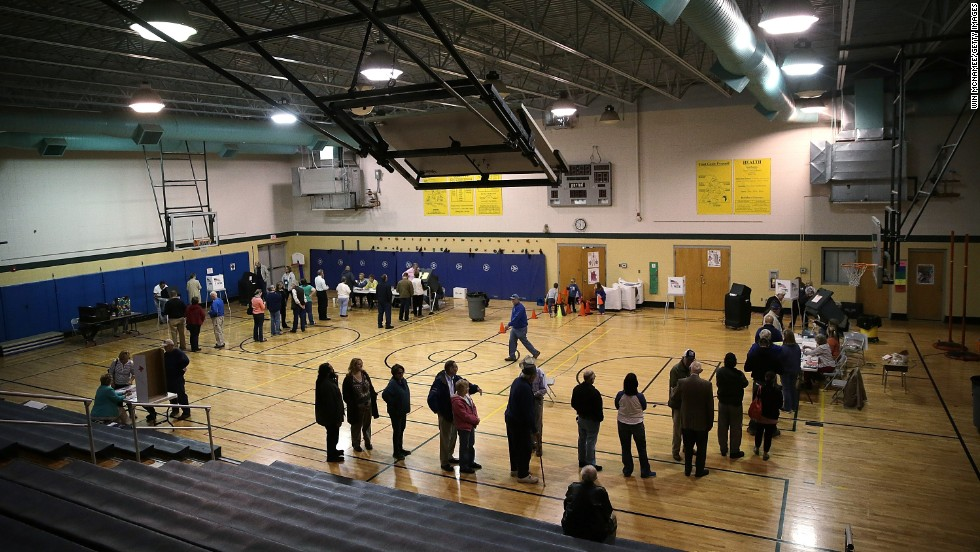 Voters line up to cast their ballots in the gym at Northside Elementary School in Midway, Kentucky.