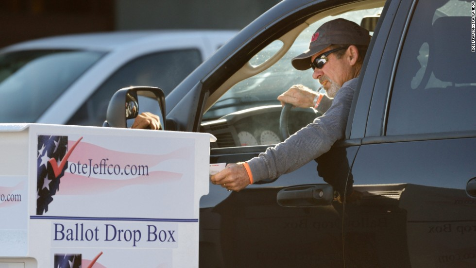 A voter drops his election ballot at one of many drop boxes in Arvada, Colorado, a Denver suburb.