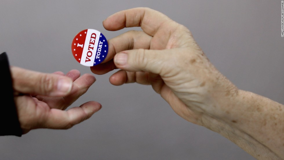 Voters get a sticker after casting their ballots on Election Day at the Red Oak Fire Department.