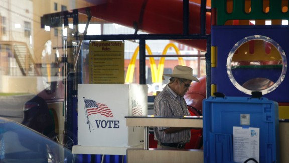 People in Los Angeles vote at a polling place set up in the playground of a McDonald