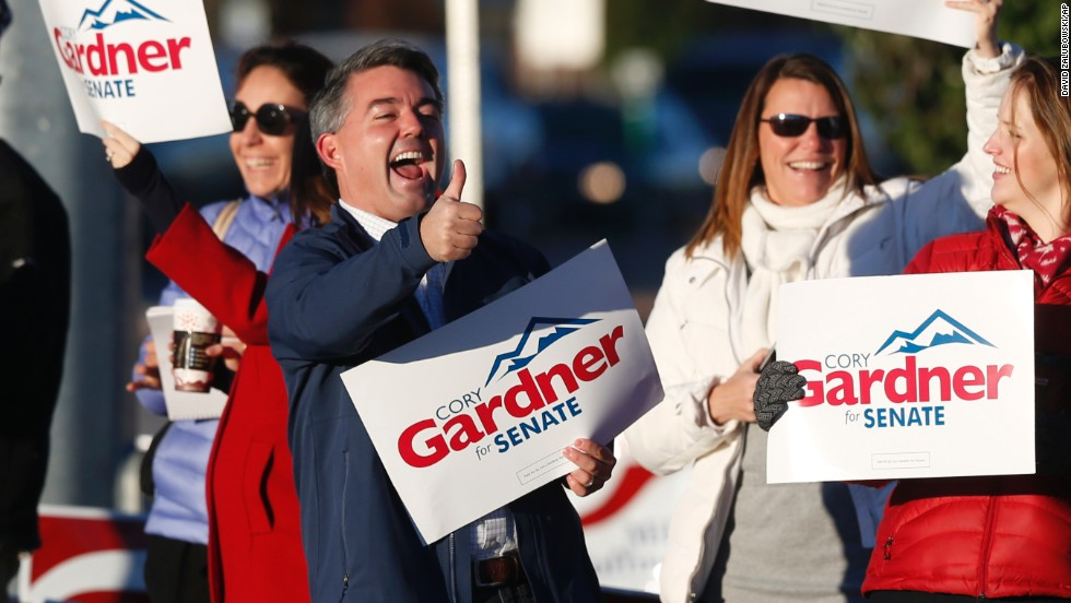 Gardner joins supporters on the corner of a major intersection in Centennial, Colorado, a Denver suburb, on Election Day.