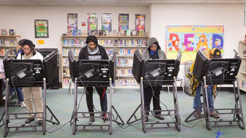 People vote in a library near Ferguson, Missouri.