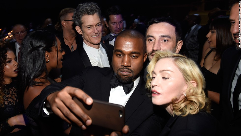 Rapper Kanye West takes a selfie with fashion designer Riccardo Tisci and pop icon Madonna at a charity event in New York on Thursday, October 30. They were attending the annual Black Ball for Keep a Child Alive, which raises money for families affected by HIV and AIDS.