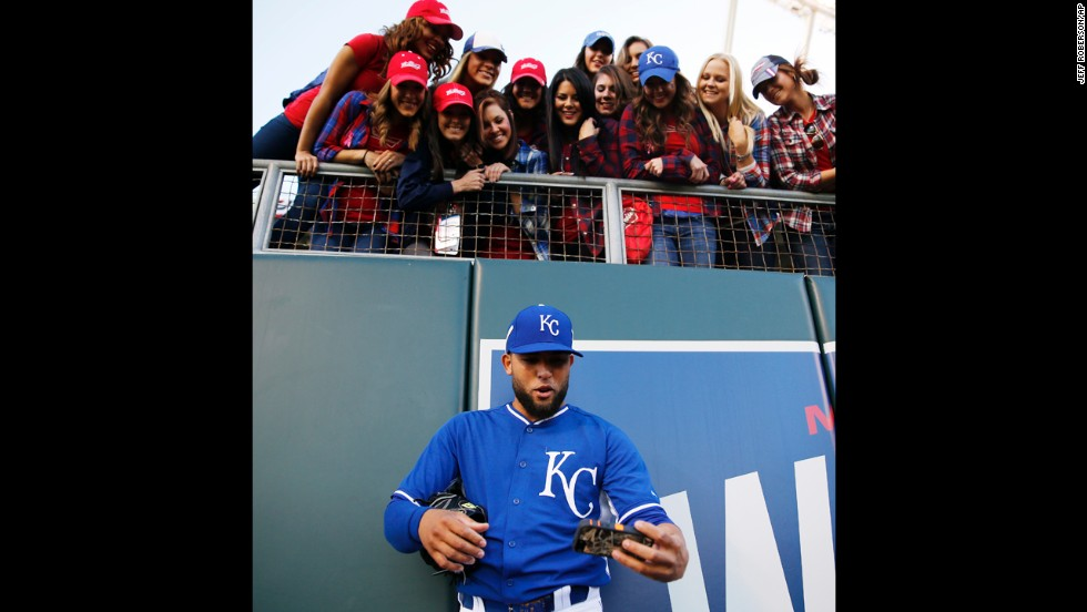 Kelvin Herrera, a baseball player with the Kansas City Royals, takes a selfie with fans in Kansas City, Missouri, before Game 7 of the World Series on Wednesday, October 29.