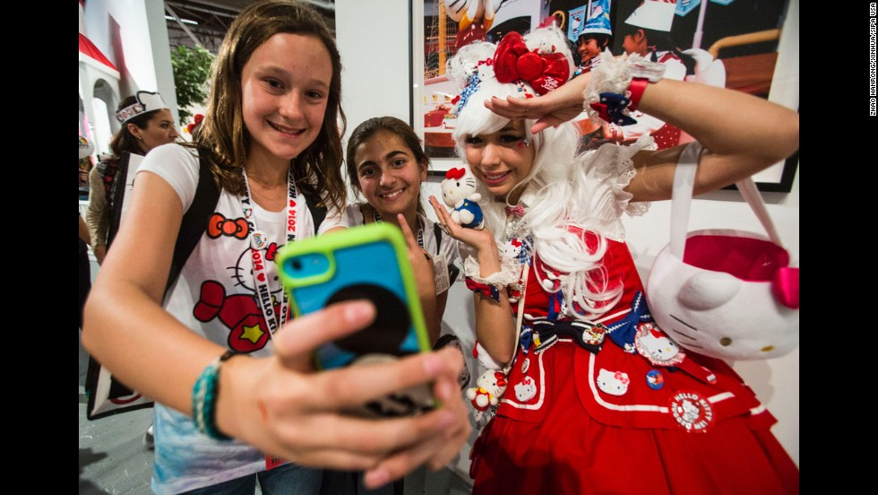 Young Hello Kitty fans in Los Angeles take a selfie with a model at Hello Kitty Con, a Hello Kitty fan convention on Thursday, October 30. The convention was held to honor the iconic character's 40th birthday.