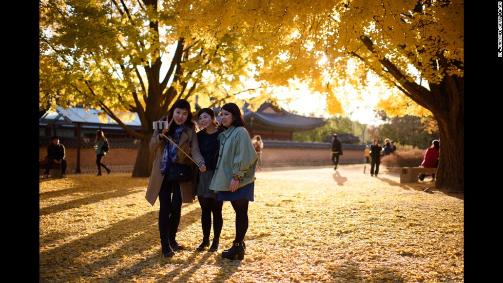 Women in Seoul, South Korea, pose for a selfie inside the grounds of the Gyeongbokgung Palace on Monday, November 3.
