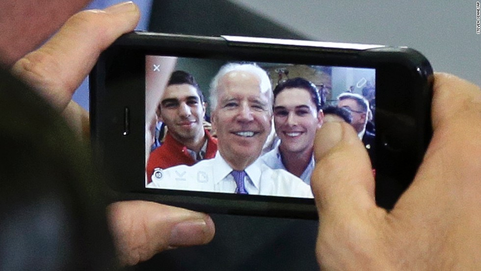 U.S. Vice President Joe Biden, center, takes a selfie with audience members in Lynn, Massachusetts, during a campaign stop for congressional candidate Seth Moulton on Wednesday, October 29.