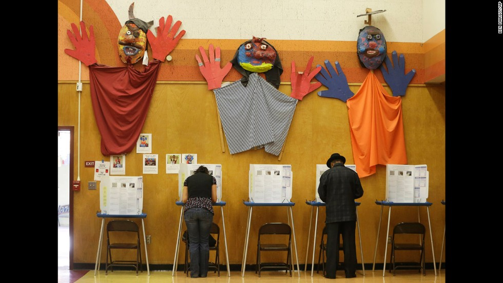 Voters cast ballots at Manzanita Community School in Oakland, California.