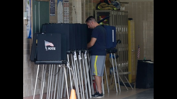 A man casts his ballot inside a Miami fire station on November 4.