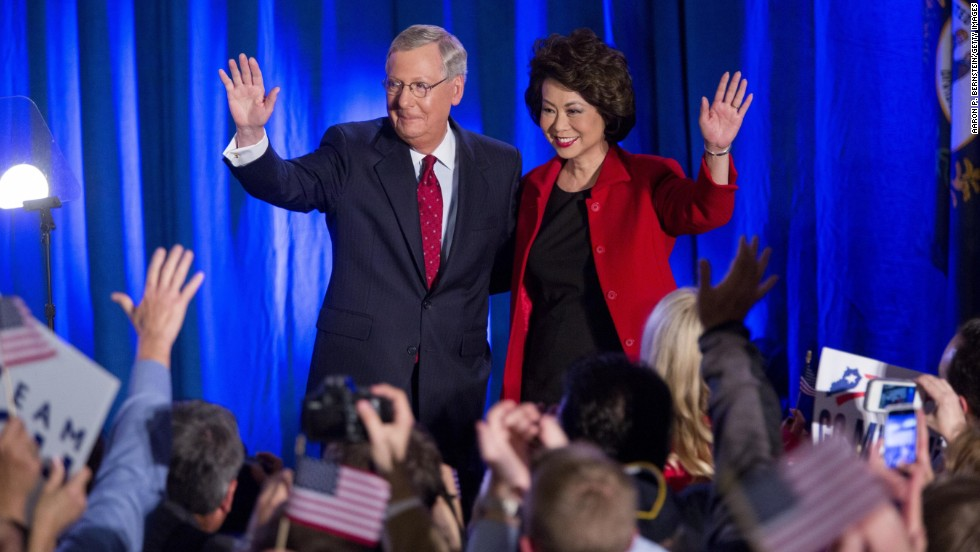 Senate Minority Leader Mitch McConnell and his wife, Elaine Chao, celebrate in Louisville, Kentucky, after he was projected to win re-election Tuesday, November 4. McConnell, a Republican, fended off a challenge from Democrat Alison Lundergan Grimes to win a sixth term in the Senate.