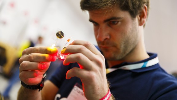 A delegate fiddles with wires and LEDs to construct a basic light at the Web Summit.