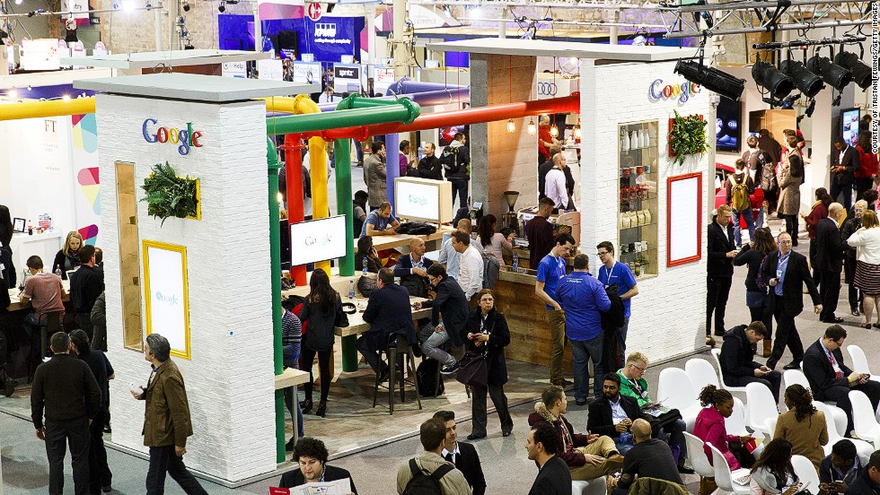 Attendees are pictured getting their caffeine fix from the Google cafe - a Google-themed coffee hotspot.