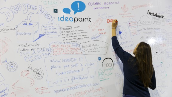 Attendees draw out their tech inspired ideas and thoughts on a huge IdeaPaint whiteboard throughout the event.