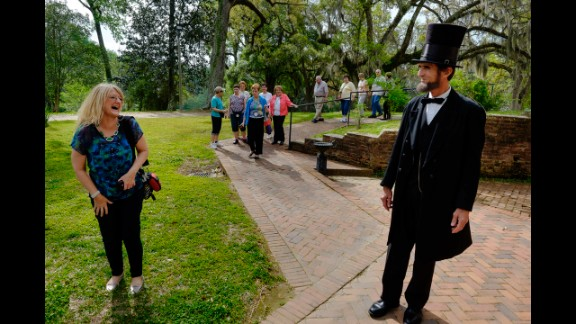 One of the Lincoln lookalikes, Robert Broski, talks with visitors at the annual convention.