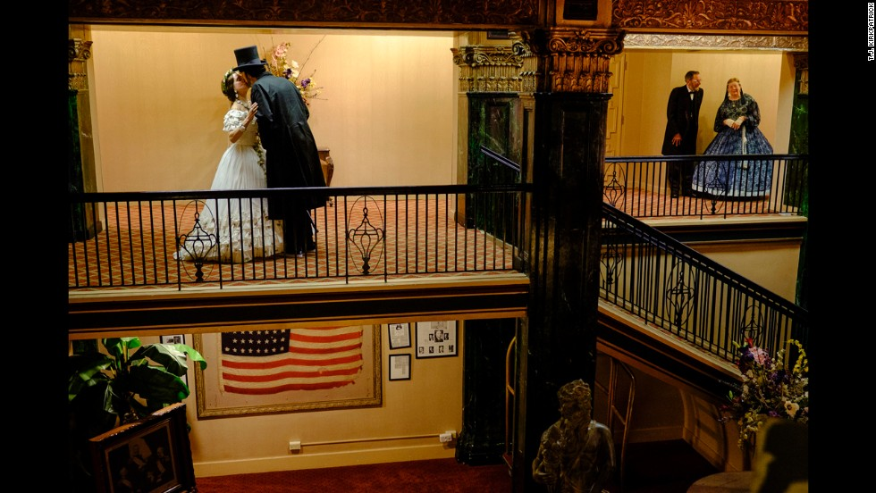 An Abe and Mary kiss outside of a ballroom at the Eola Hotel in Natchez.