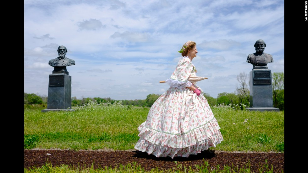 A woman dressed as Mary Todd Lincoln passes by a memorial at Vicksburg Military Park in Vicksburg, Mississippi.