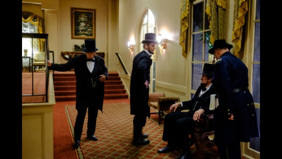 Lincoln impersonators mingle in the Eola Hotel lobby.