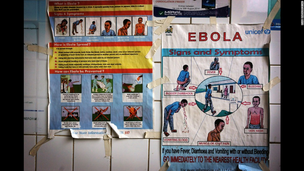 Posters warn and explain the symptoms ebola.