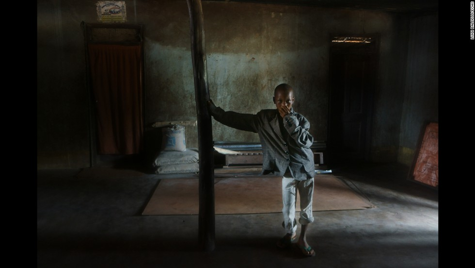 A boy leans against a structure in the Zimmi Village. In this village at least two people have died of Ebola.