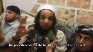 Video shows ISIS fighters trading women
