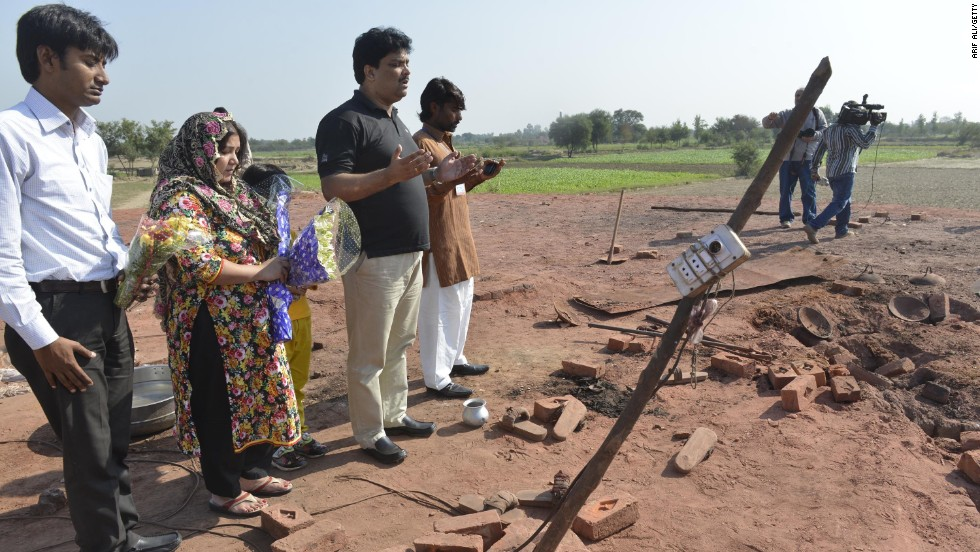 Pakistan relatives pray at the site of the murder on November 5. The HRCP, said it appeared the incident stemmed from a dispute over money with the kiln's owners. It found no evidence that a Quran had been desecrated.