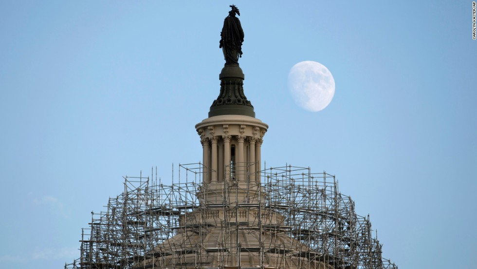 The moon rises over the Capitol dome in Washington on Monday, November 3. The scaffolding is part of a repair project to fix cracks, leaks and corrosion in the cast-iron structure.