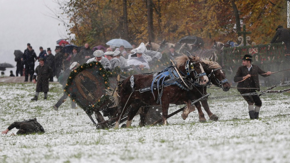 A man falls off a carriage after the horses bolted during the traditional Leonhardi pilgrimage in Bad Toelz, southern Germany, on Thursday, November 6. The annual pilgrimage honors St. Leonhard, patron saint of the highland farmers for horses and livestock.