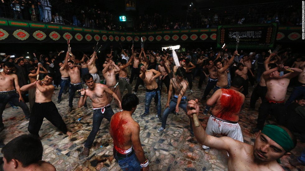 Afghan Shi'ite Muslim men flagellate themselves during a Muharram procession in Kabul on Friday, October 31. Ashura, which falls on the 10th day of the Islamic month of Muharram, commemorates the death of Imam Hussain, grandson of Prophet Mohammed, who was killed in the 7th century battle of Karbala.