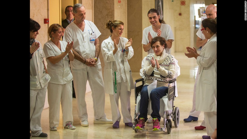 Teresa Romero, sitting in a wheelchair, celebrates with medical workers in the Carlos III Hospital in Madrid on Wednesday, November 5. Romero, a Spanish nursing assistant, was discharged from the hospital a month after she was admitted with the Ebola virus. She was the first person known to have contracted the disease outside of West Africa in the latest outbreak.