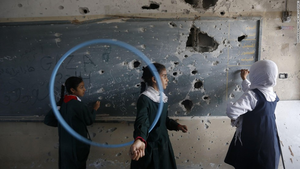 Palestinian girls play inside their school in Gaza on Wednesday, November 5. The school was damaged during the conflict between Israel and Hamas last summer.