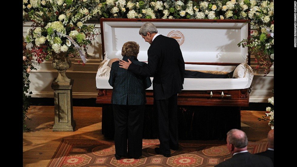 U.S. Secretary of State John Kerry and widow Angela Menino stand at former Boston Mayor Tom Menino's casket at Faneuil Hall in Boston on Sunday, November 2. Menino, the longest-serving mayor in Boston history, died Thursday, October 30. He was 71.
