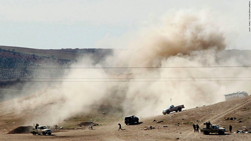 A picture taken from Turkey shows smoke rising after ISIS militants fired mortar shells toward an area controlled by Syrian Kurdish fighters near Kobani on Monday, November 3.