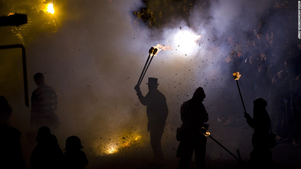 A participant in costume holds a torch as bonfire societies parade through the streets of Lewes in Sussex, England, on Wednesday, November 5, during the traditional Bonfire Night celebrations.  The celebrations are related to the ancient festival of Samhain, the Celtic New Year.