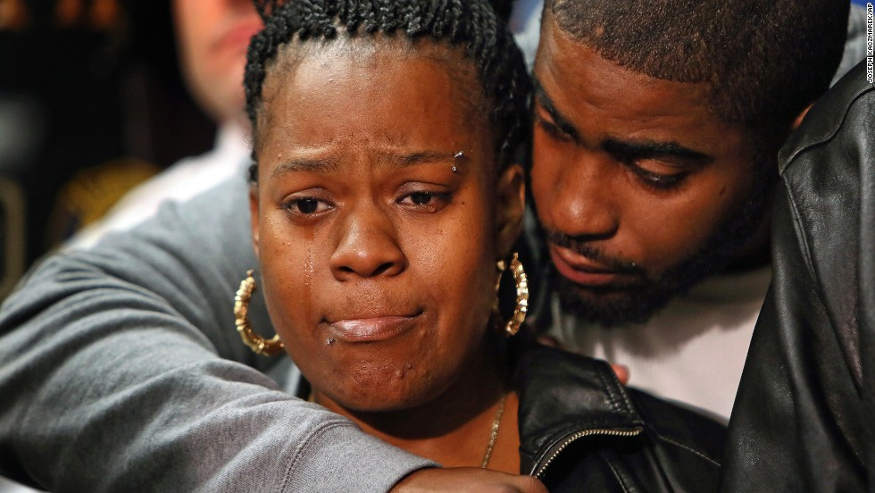 Keisha Gaither, mother of kidnapping victim Carlesha Freeland-Gaither, is comforted during a news conference in Philadelphia on Tuesday, November 4.  Freeland-Gaither was found alive in Maryland three days after her abduction was captured on a surveillance video in Philadelphia, sparking an all-out manhunt.