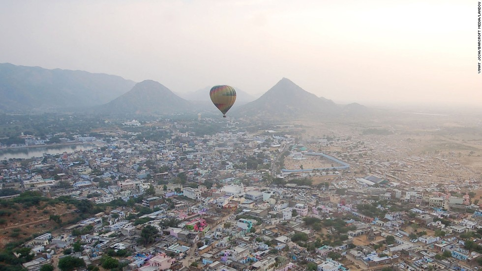 A hot air balloon flies over the International Pushkar Fair on Monday, November 3, in Pushkar, India. The weeklong event is the largest cattle exhibition and trading fair in the country.
