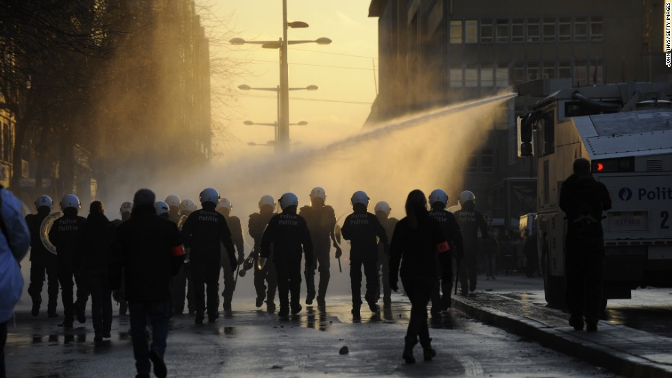 Riot police responded using water cannons and pepper spray to control the crowds.