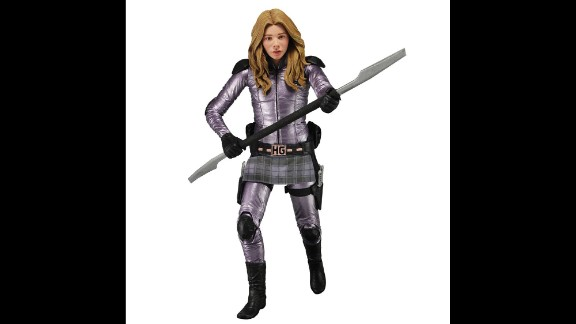 "Hit Girl is one of Marvel Comics' crime-fighting ""Kick Ass"" crew. The young assassin projects elements of school-girl innocence with her plaid skirt and purple color scheme. But the spear-wielding action figure is all business."