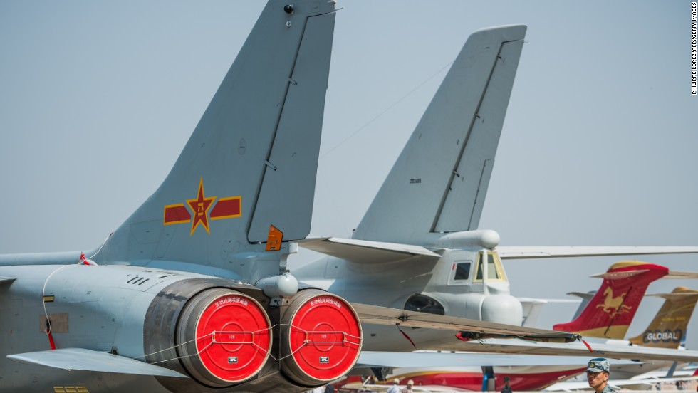 A soldier stands guard next to planes displayed during the airshow on November 13, 2012. While most Western aircraft manufacturers stay aloft thanks to sales of commercial jets, China's state-funded aerospace industry is heavily geared toward the military.