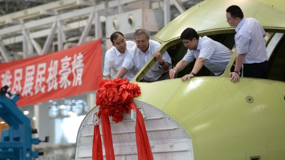 A new C919 airliner is celebrated on July 31 in Chengdu, China. The 168-seat C919, being built by the Shanghai-based Commercial Aircraft Corporation of China, is supposed to someday be the nucleus of a fleet of Chinese-built passenger aircraft.