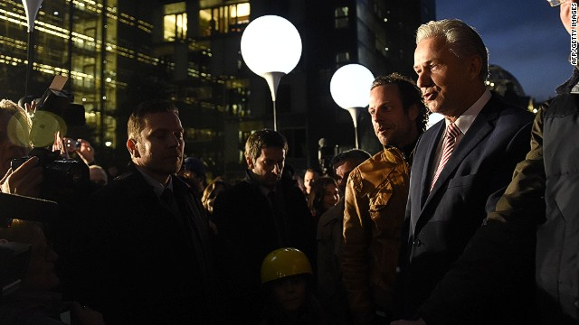 Berlin's Mayor Klaus Wowereit (2nd R) and Moritz van Duelmen (R), director of cultural not-for-profit organization Kulturprojekte Berlin attend the start of the light installation Lichtgrenze (Light border) on the course of the former Berlin wall in Berlin on November 7, 2014. Germany kicked off celebrations of the 25th anniversary of the epochal fall of the Berlin Wall Friday, set to culminate in rock stars and freedom icons joining millions at an open-air party. AFP PHOTO / TOBIAS SCHWARZTOBIAS SCHWARZ/AFP/Getty Images