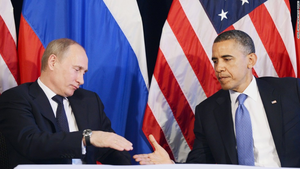 "Obama shakes hands with Putin after a meeting at the G20 summit in 2012. Obama said that the pair had a ""candid, thoughtful and thorough conversation"" about various foreign policy topics including Syria and Iran."