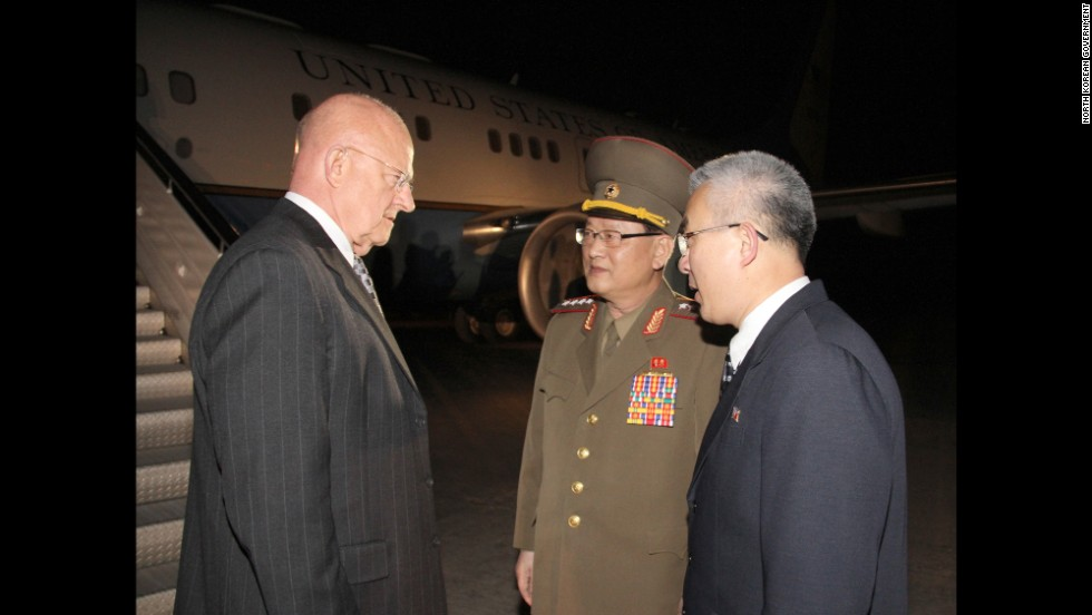 U.S. Director of National Intelligence James Clapper is greeted by North Korean officials after arriving in Pyongyang on Friday, November 7.